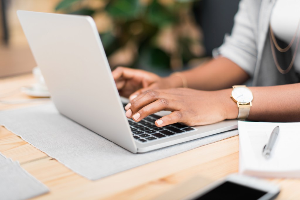 Woman generating sales from laptop