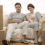 Moving Couple Sitting on Couch