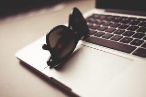 macbook with sunglasses