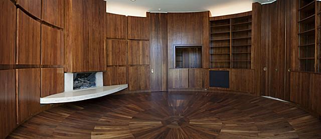 Round library with bar, hidden and open storage. Photo via Brants Realtors