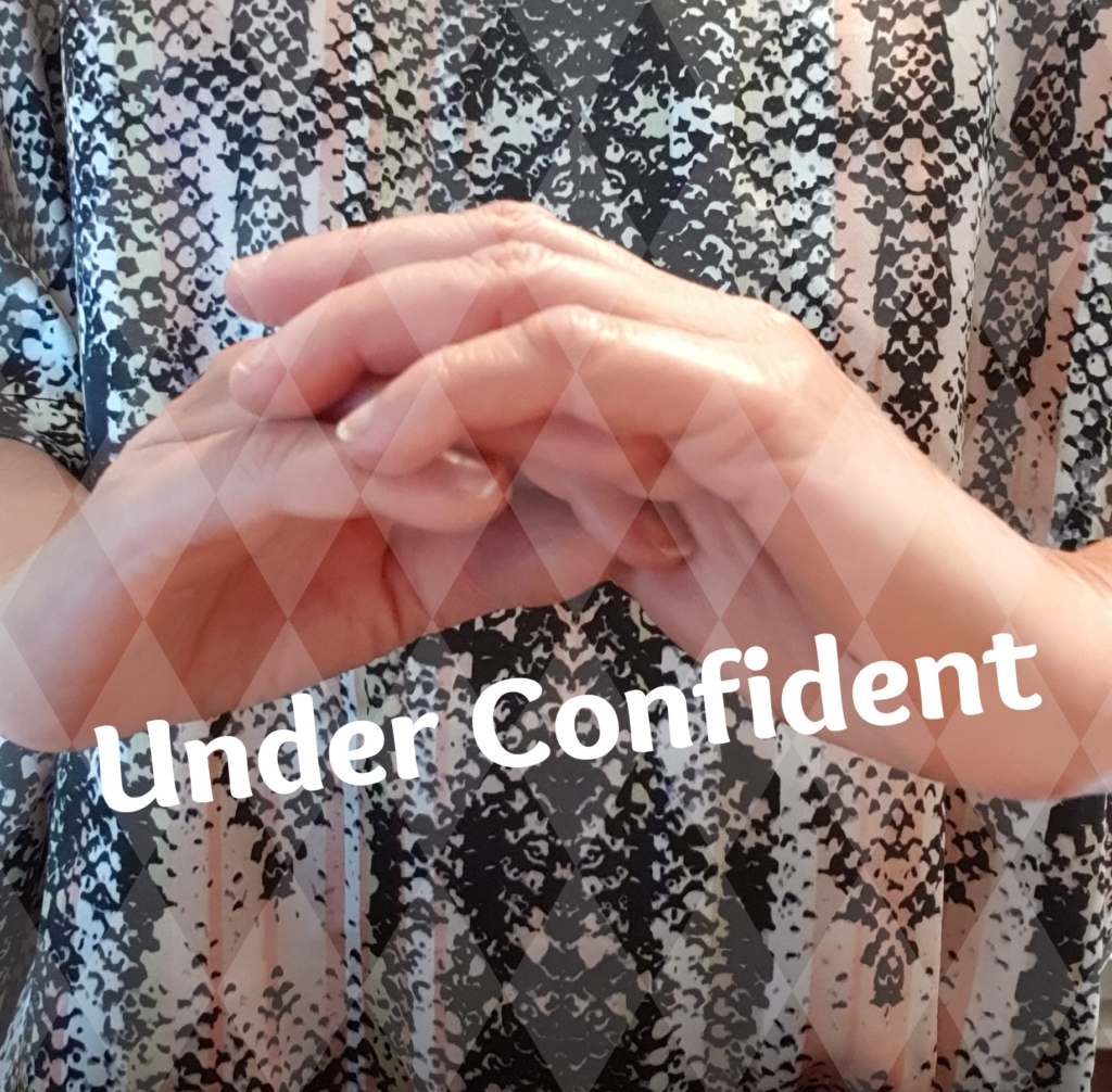 Under confident woman is a label.